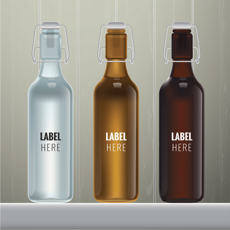 orange water: blank glass bottles in three colours on wood background