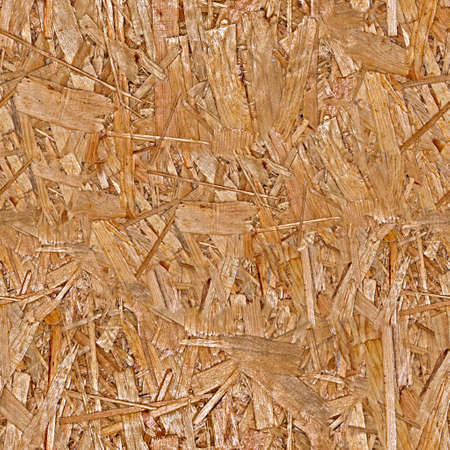 Pressed wood chipboard texture. Seamless pattern. Stock Photo