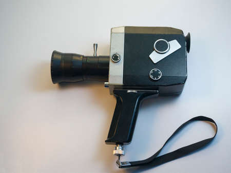 Retro 16mm video camera on white background.
