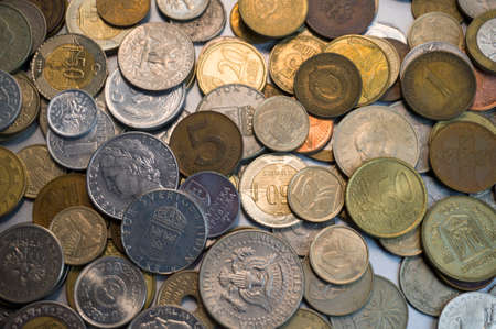 Collection of different coins background. Overhead Close up.
