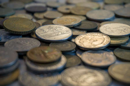 Collection of different coins background. Close up. Imagens