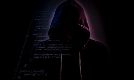 Malicious figure in hood lurking in the dark with some code layer