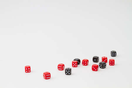 Random set of 13 red and black dices on white isolated background Stock Photo