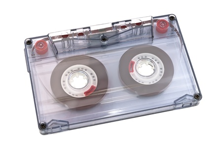 Vintage audio tape isolated on white background.  Фото со стока