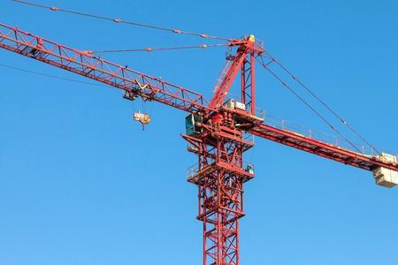 Tower crane on blue sky background. photo