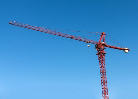 hight tech: Tower crane on blue sky background.