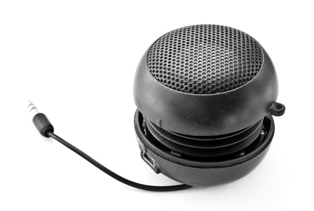 Portable mini speaker on a white background.  photo