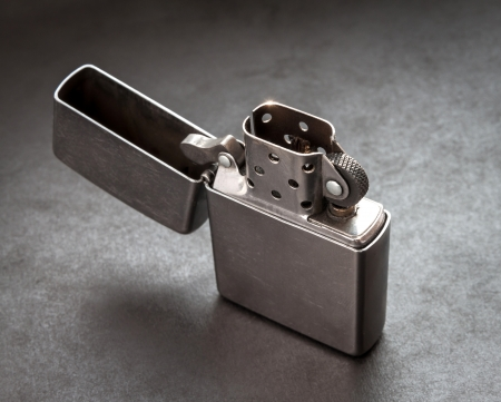 Silver metal lighter on black background Stock Photo - 18511864