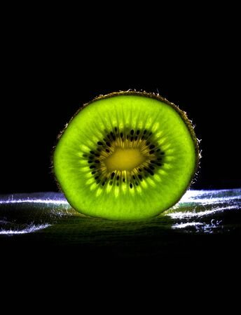 Slice of kiwi with back-light. photo