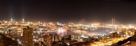 Vladivostok cityscape night view from east to west, panorama. photo