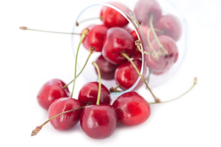 Cherry in a glass on white background.  photo