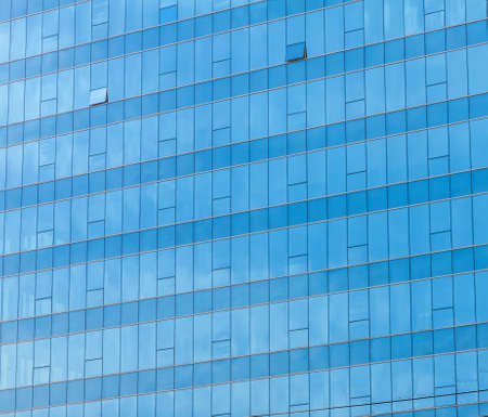 Blue sky reflected in the glass building.  photo