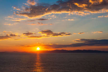 Beautiful sunset with clouds and sea. Stock Photo - 18526278