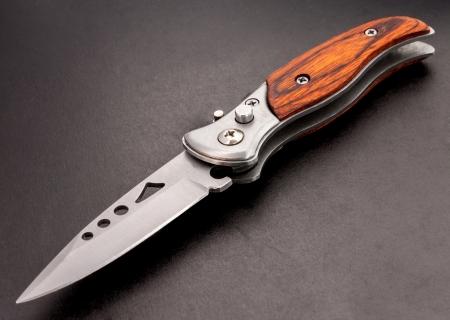Open Pocket knife on black background. Stock Photo - 18565646