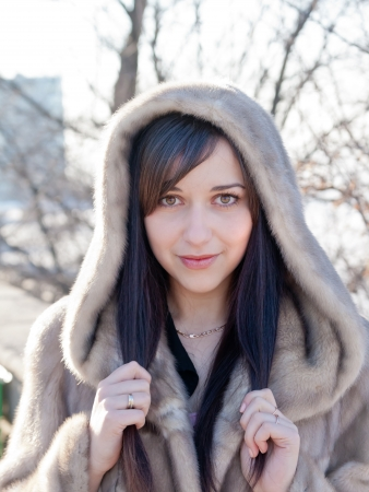 Winter girl portrait in a fur coat with bokeh background. Stock Photo - 18565442