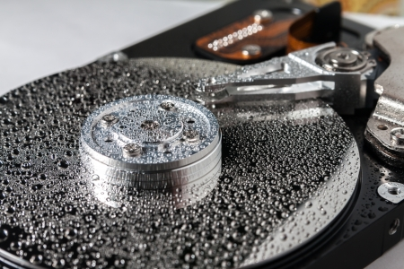 Hard disk drive with water drops.  photo