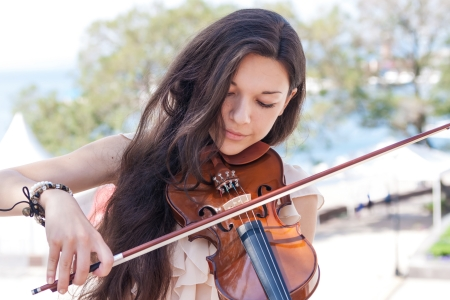 Pretty young female playing the violin, soft focus  photo