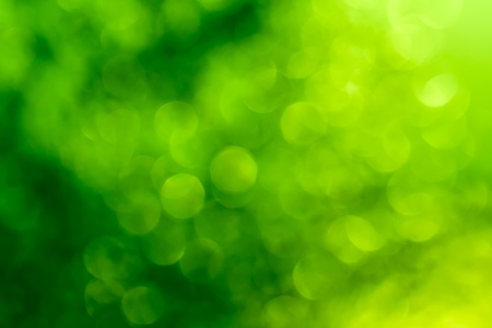Abstract circular green bokeh background  Imagens