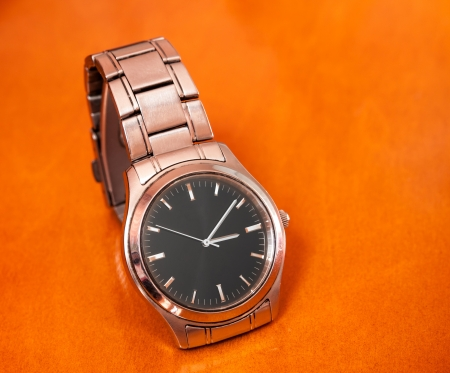 Wrist watch on an wooden background. photo