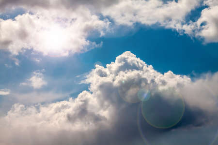 Cloudy sky with sun and glare. Stock Photo - 18852307