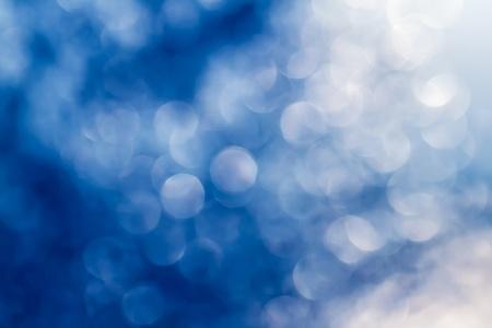 Abstract circular blue bokeh background