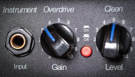Retro guitar amplifier control panel, close up. Shallow depth of field. photo