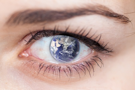 Human Eye with the earth and stars inside. photo