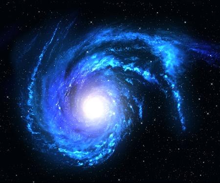 blue spiral: Blue spiral galaxy in deep space with star field background.