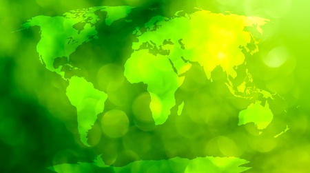 bionomics: World map, continents in green bokeh background   Stock Photo