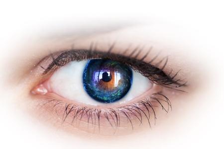 Human eye with galaxy inside.