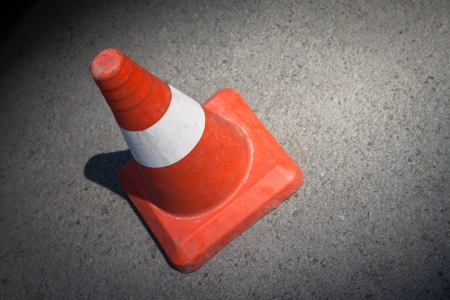 Traffic cone on asphalt surface. photo