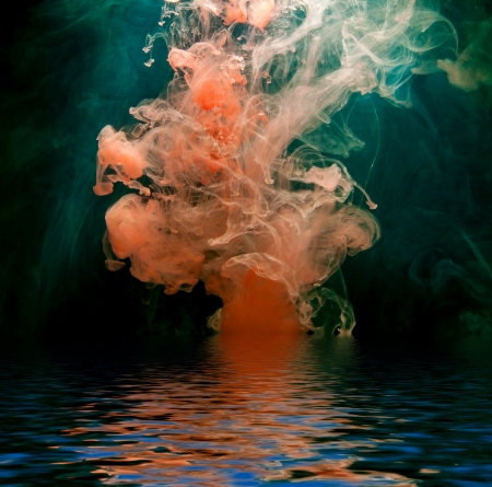 Red ink reflected in water surface  Conceptual photo