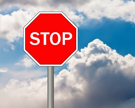 Stop sign on blue cloudy sky background   photo