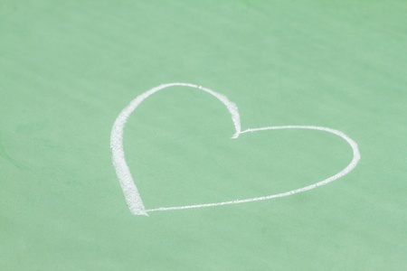 Heart shape chalk drawing on chalkboard   Stock Photo - 20735855