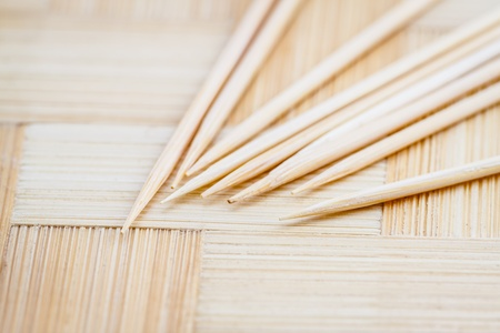 eddy:   Close up of the toothpicks on wooden background  Shallow depth of field  Selective focus