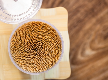 Close up of the toothpicks on wooden background  Shallow depth of field  Selective focus Stock Photo - 21384028