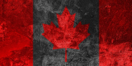 Canadian Flag on grunge cement background  photo