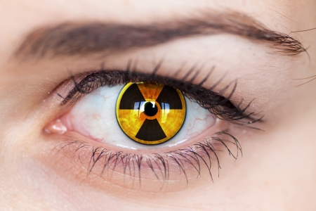 radiation hazard:   Human eye with radiation hazard symbol - concept photo   Stock Photo
