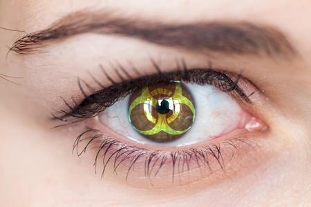 radioisotope:    Human eye with biohazard symbol - concept photo
