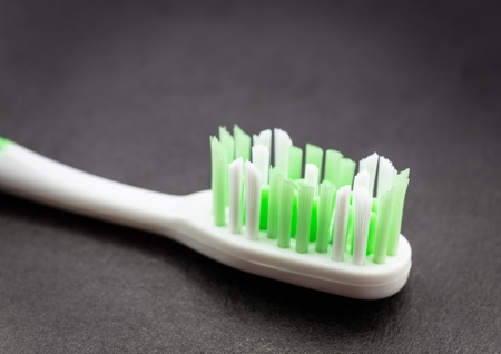 Toothbrush on dark surface   photo