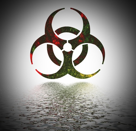 infectious waste:   Biohazard warning sign reflected in water surface