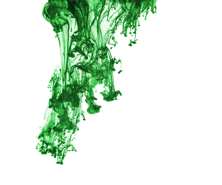 venom:  Green ink in water on a white background  Stock Photo