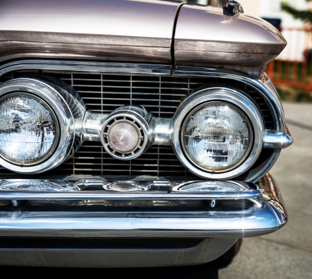 car grill: Headlight of a vintage car   Stock Photo