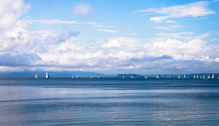 Seascape with sailboats the background of the blue sky