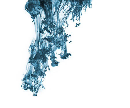 Blue ink in water on a white background  photo