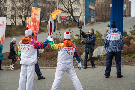 VLADIVOSTOK, RUSSIA - NOVEMBER 16  torchbearer carries the Olympic flame in relay of Olympic Flame on November, 2013 in Vladivostok, Russia