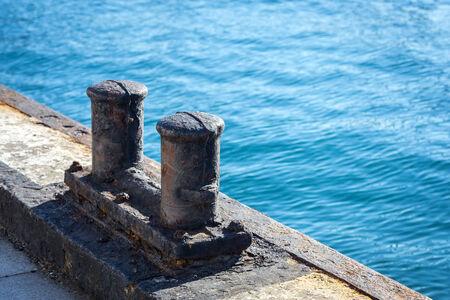 bollard:   Old and rusty ships mooring bollard