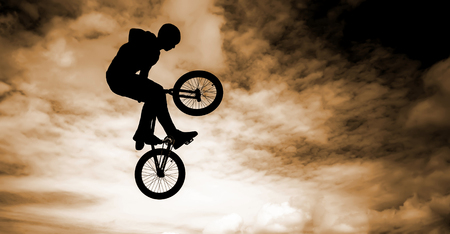 Silhouette of a man with a bmx bike   photo