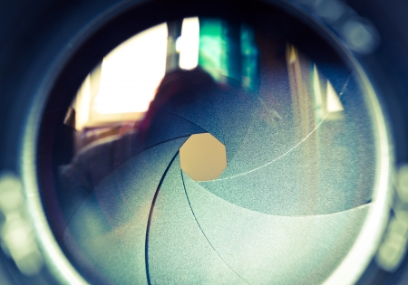 The diaphragm of a camera lens aperture  Selective focus with shallow depth of field  Color toned image