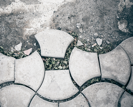 Old and cracked tile road - abstract background  Color toned image   photo